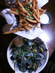 Moules & Frites served at Victoire. Pictured are the Snobby mussels, in lobster stock, organic herb blend, champagne and cream.