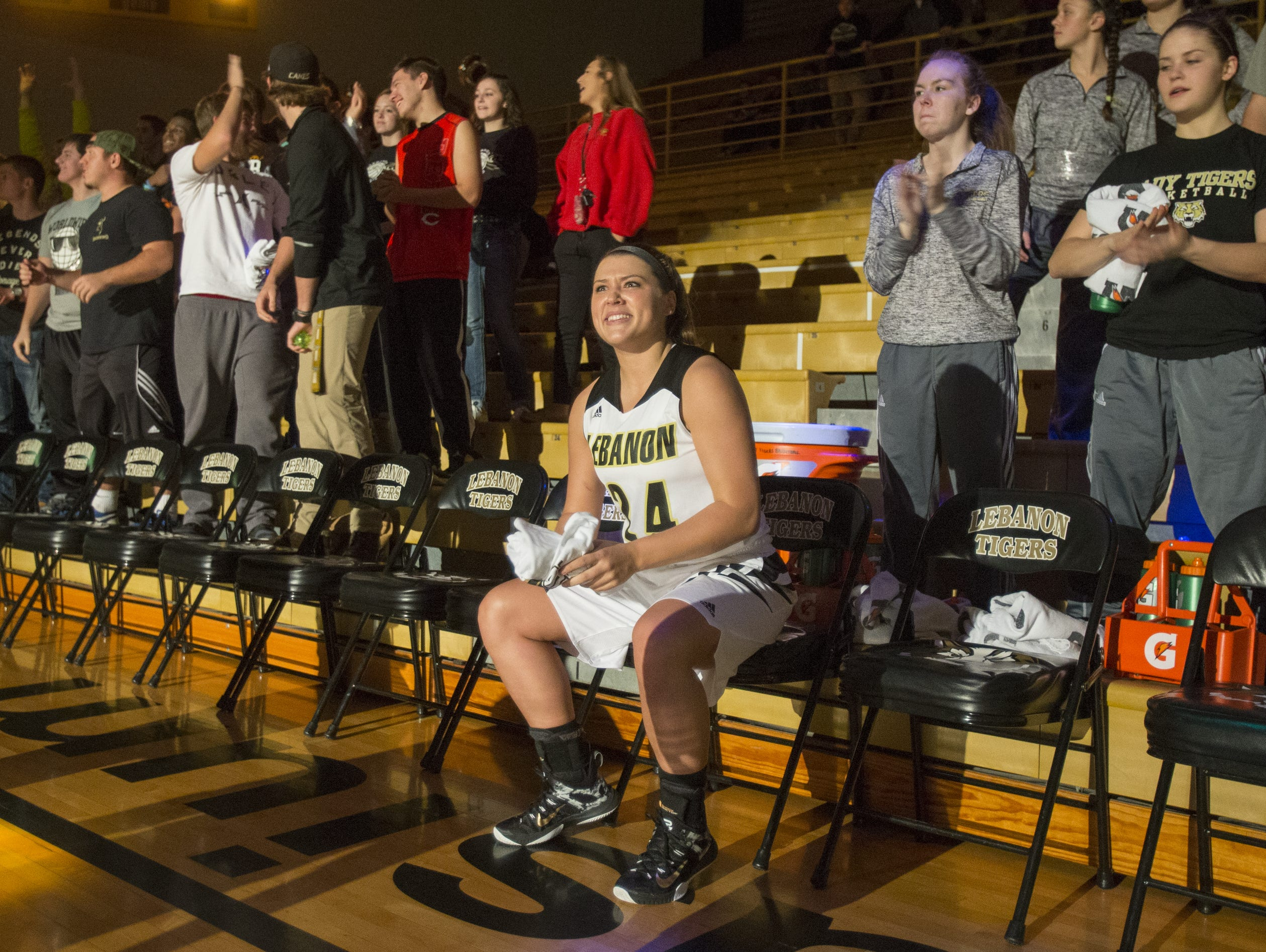 Kristen Spolyar smiles as she is announced during pre-game introductions for Lebanon High School, Lebanon, Monday, Nov. 30, 2015. Spolyar, who has scored more than 2,000 points in her high school career, finished with 45 this game.