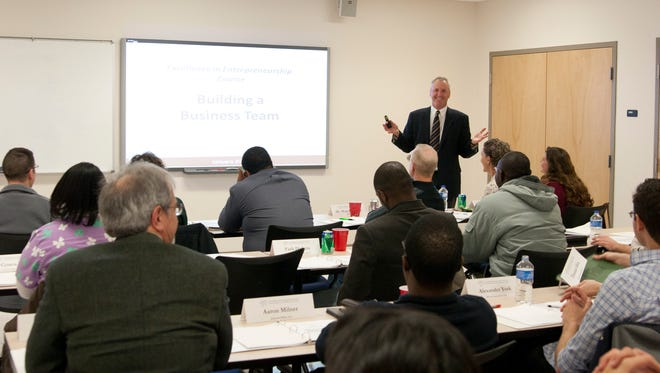 Director Larry Lynch of the Entrepreneurial Excellence Program addresses trainees at a past session.