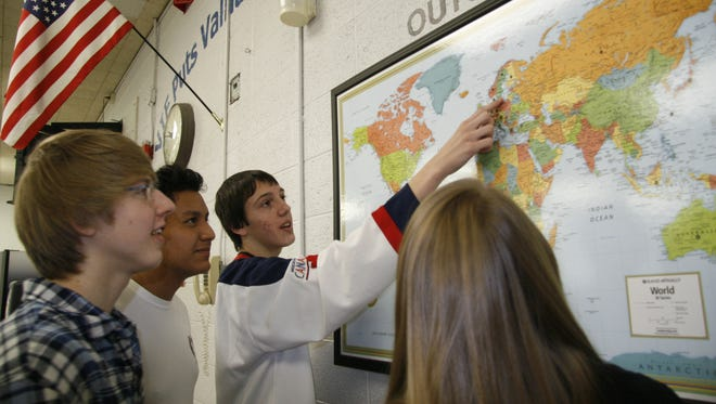 Ian Everett, center, a Valhalla High School senior, points on a map to Uppsala, Sweden, which he visited in 2008 through the school's Valhalla International Fund. Also in the picture, from left, are German exchange student Hendrik Fiedler, senior Zachary Morrice and senior Giovanna Olson.
