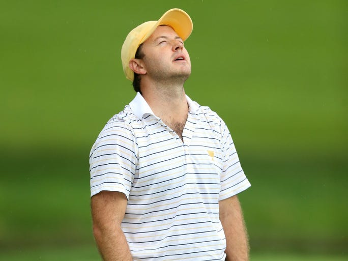 Richard Sterne reacts to his putt on the 9th green.