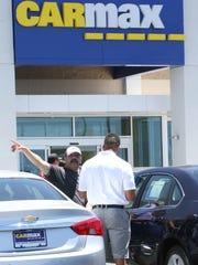 El Pasoan Daniel Renteria talks with CarMax salesman