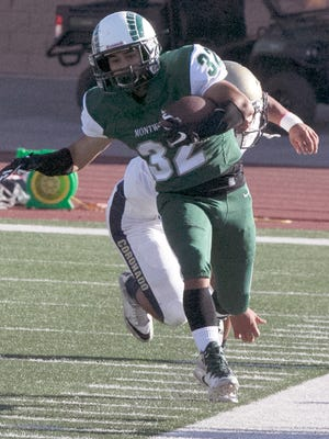 Montwood running back Evan De Anda, 32, runs out of bounds while being chased by a Coronado defender Friday.