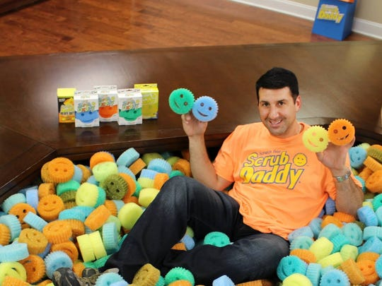 Scrub Daddy inventor Aaron Krause sits in a pit of his product