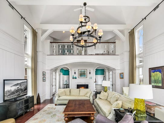 The great room features high ceiling and wonderful decorative molding.