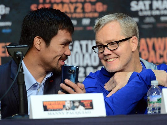 Manny Pacquiao and Freddie Roach talk during a press