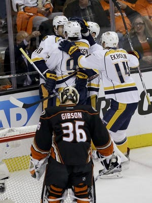 The Predators celebrate after James Neal's goal past Anaheim Ducks goalie John Gibson, foreground, during the first period.