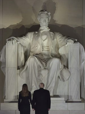 Donald and Melania Trump at the Lincoln Memorial the day before he took office, Washington, Jan. 19, 2017.