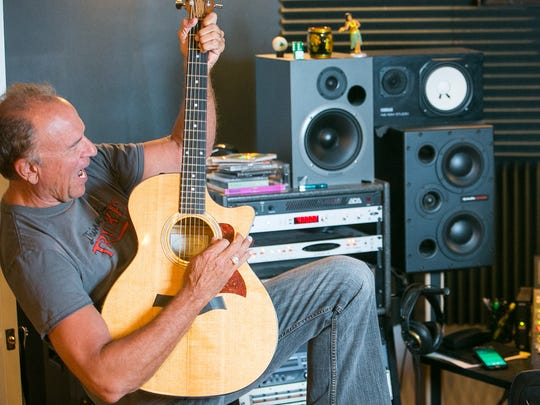 Former Arizona attorney general Grant Woods jams along to a song with studio owner and engineer Sean Cooney at 3 Leaf Recording in Phoenix, Tuesday, May 19, 2015.