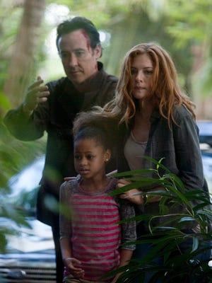 "John Cusack, Briana Roy and Rachelle Lefevre star in ""Reclaim."""
