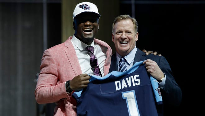 Western Michigan's Corey Davis, left, poses with NFL commissioner Roger Goodell after being selected by the Tennessee Titans during the first round of the 2017 NFL draft.
