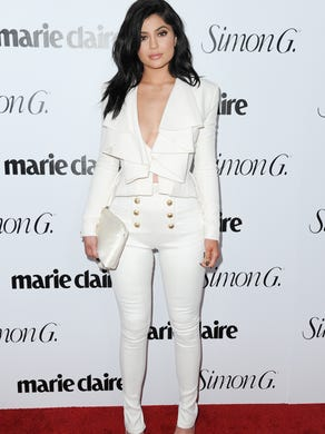 Jenner looked business-chic in high-waisted pants and a ruffled top from Balmain at Marie Claire's Fresh Faces Party on April 11, 2016, in Los Angeles.