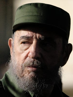 This file photo taken on June 21, 2004, shows Cuban President Fidel Castro looking at the crowd prior to his speech in front of the U.S. Interests Section in Havana.  The Cuban revolutionary icon Fidel Castro died late on Nov. 25, 2016, in Havana.
