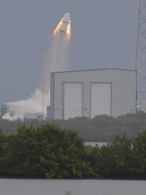 The SpaceX Dragon crew capsule and trunk blasts into the air during today's pad abort test at Cape Canaveral Air Force Station.