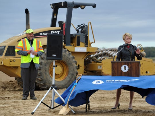 Indiana Lt., Gov., Sue Ellspermann speaks as INDOT's Vincennes District Deputy Commissioner Rusty Fowler listens during Thursday's ground breaking ceremony on the Boonville Bypass project.  The $19.6 million project is expected to be completed by the end of 2017.