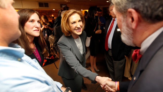 Former Hewlett-Packard CEO Carly Fiorina, shakes hands as she arrives for a business luncheon at the Barley House with New Hampshire Republican lawmakers.