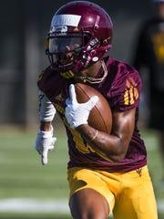ASU WR John Humphrey runs after a catch during practice,