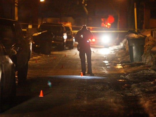 Rochester police investigate a stabbing on Trenaman Street March 10, 2015.