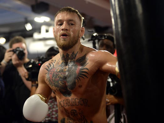 Conor McGregor hits a heavy bag during a media workout