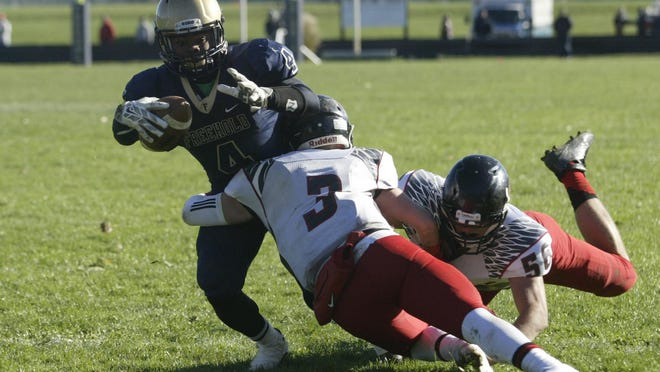 Freehold sophomore running back Ashante Worthy gets tackled by Allentown's Jordan Winston (3) and Andrew Whalen in Saturday's NJSIAA Central Group IV playoff game.