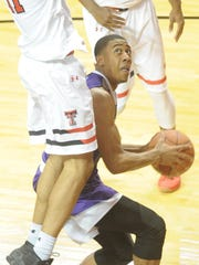 ACU's Jaren Lewis looks to shoot while being guarded by two Texas Tech players during their 2017 game in Lubbock.