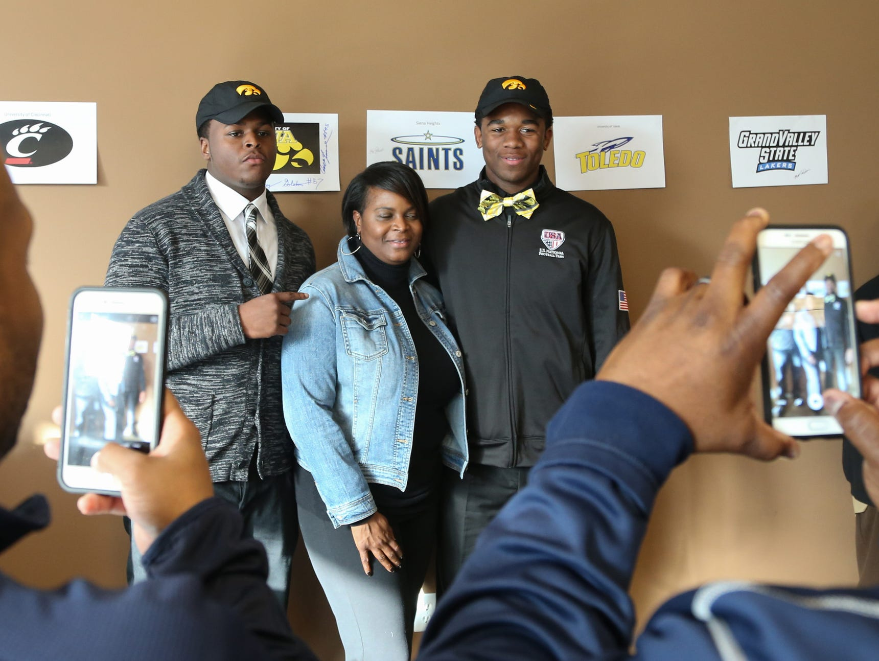 East English Village High's Cedrick Lattimore his mom, Carla Spivey, and Chauncey Golston signed a letter of intent to play football at Iowa on Wednesday.