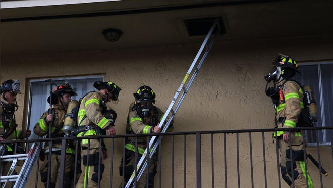 Palm Beach County Fire Rescue crews deal with smoke and flames at the Palo Verde Apartments at Forest Hill and Sherwood Forest boulevards near Greenacres on Thursday, Jan. 30, 2020.