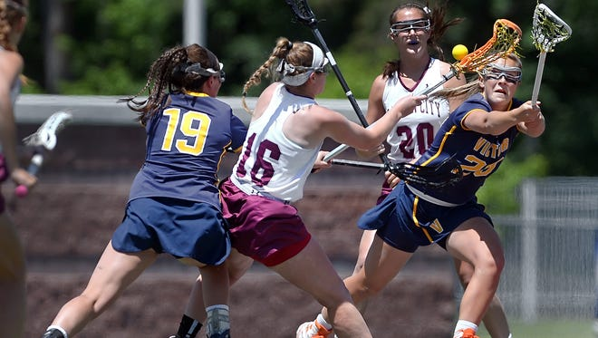 Emily Hawryschuk, right, and Bridget Flynn, left, pressure Garden City's Kerry Defliese for the ball during a NYSPHSAA 2016 State Girls Lacrosse Championships Class B semifinal at SUNY Cortland on June 10, 2016. Victor's season ended with a 15-11 loss to Garden City-VIII.