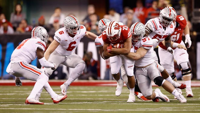 Wisconsin running back Jonathan Taylor hopes to have better success vs. Miami on Saturday in the Orange Bowl than he did against Ohio State in the Big Ten title game.