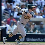 Jun 16, 2015; San Diego, CA, USA; Oakland Athletics second baseman Eric Sogard (28) hits an RBI single during the ninth inning against the San Diego Padres at Petco Park. The Athletics beat the Padres 6-5.