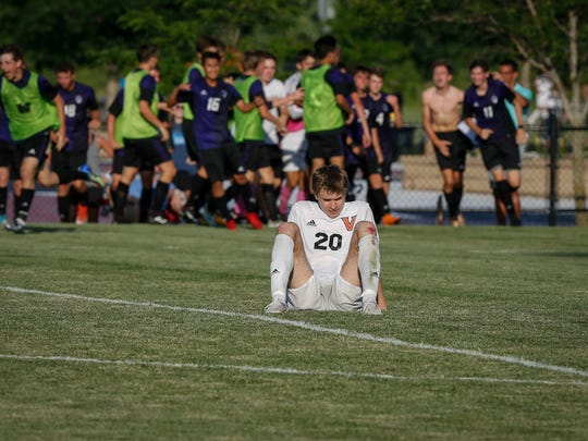 West Des Moines Valley senior Nikolaj Votlucka can't bear to watch as Waukee celebrates an overtime win in Class 3A during the 2018 boys state soccer tournament at Cownie Soccer Complex in Des Moines on Thursday, May 31, 2018.
