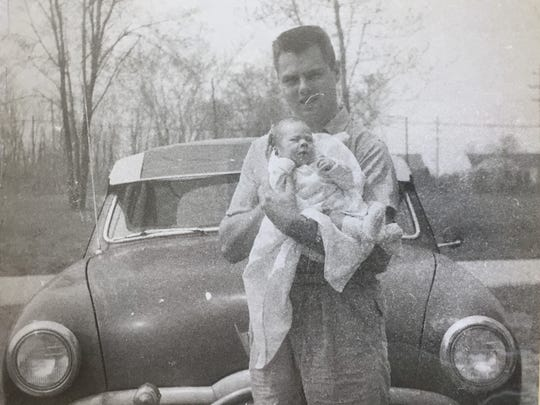 In this undated photo, Dave Hess is holding his son,