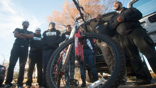 Camden County Freeholder Jonathan L. Young Sr.,  second from the right, stands with members of the Camden PowerCorps during a refurbished Bike Share donation at the PowerCorps headquarters. About 20 bikes where given to Camden residents to help them get to work.