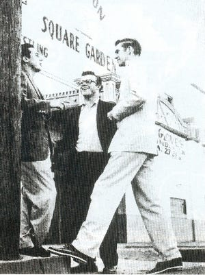 Songwriter and producer Lee Hazlewood, left, guitarist Al Casey, center, and singer Sanford Clark stand outside Phoenix's Madison Square Garden in this 1950s photo. The three collaborated on The Fool, a Top 10 national hit recorded in Phoenix in 1956.