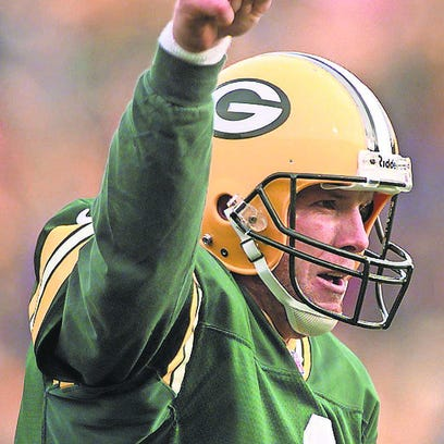 Brett Favre celebrates a two-point conversion as the