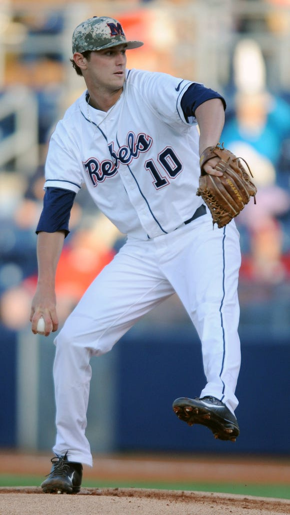 Mississippi's Chris Ellis (10) pitches against Arkansas during an NCAA college baseball game in Oxford, Miss., Friday, May 2, 2014. (AP Photo/The Oxford Eagle, Bruce Newman) MAGAZINES OUT; NO SALES; MANDATORY CREDIT