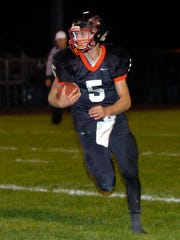 Pleasant quarterback Joe Craycraft runs the ball against North Union last year. The Wildcats made the playoffs a year ago.