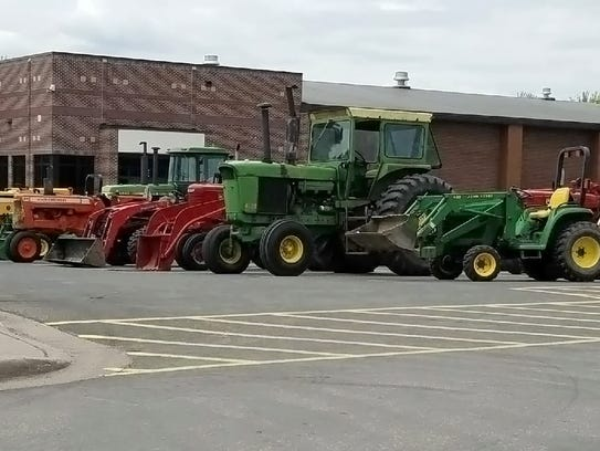 More than 30 tractors lined up outside of Colfax High