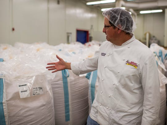 Jude Tauzin, corporate chef for Tony Chachere's Cajun Foods, conducts a tour of the company's production facility in Opelousas, La., Monday, March 23, 2015.