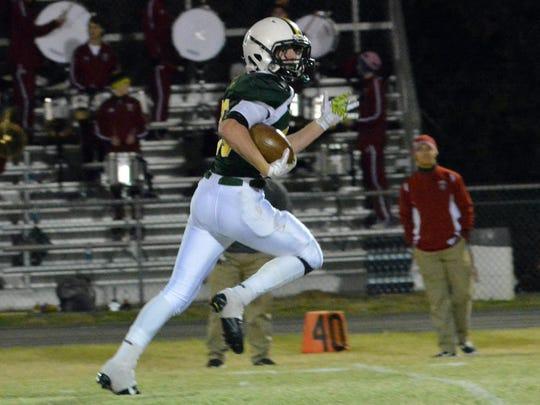 Menard junior running back Landon Baronne (25) sprints for a touchdown against Dunham in a 2014 playoff game. Baronne credits a strong senior season to his offensive linemen.