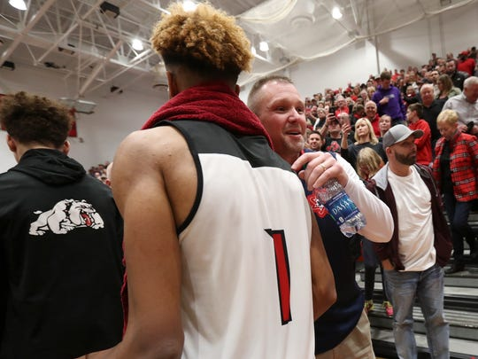 New Albany's Romeo Langford (1) was greeted by Bedford North Lawrence assistant coach Damon Bailey after their game at New Albany High School.  It is Langford's last home game.  