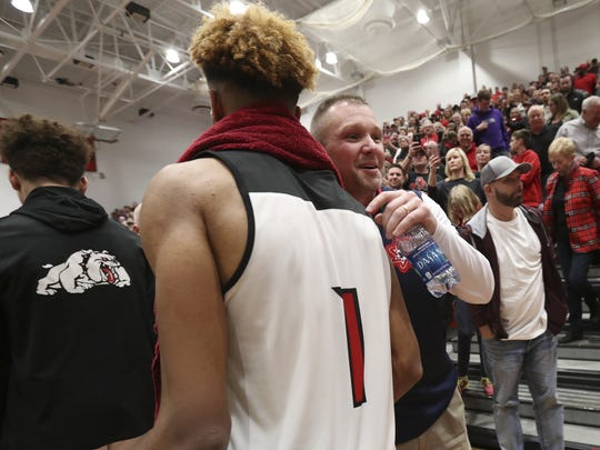 New Albany's Romeo Langford (1) was greeted by Bedford North Lawrence assistant coach Damon Bailey after their game at New Albany High School.
