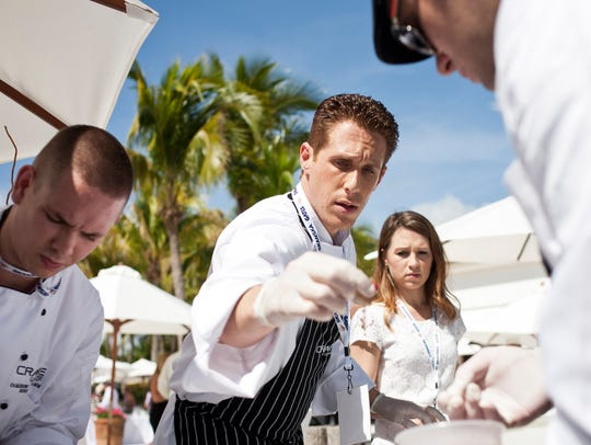 Chef Brian Roland of Crave Culinaire preps a dish during