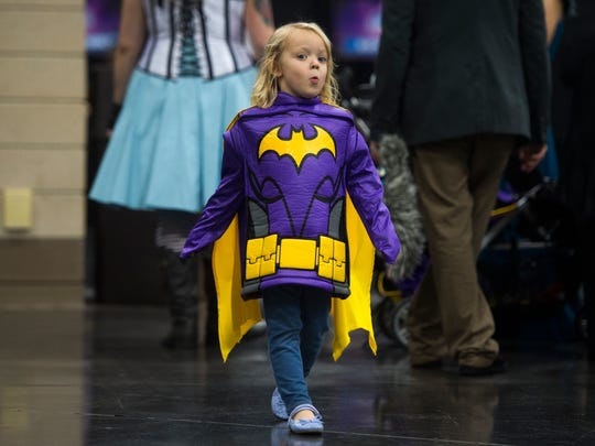 London Wasinger, 4, of Maryville walks around at the Fanboy Expo in the Knoxville Convention Center Friday, Oct. 6, 2017.