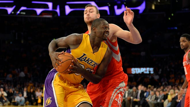 Lakers forward Julius Randle drives during the season-opener against the Rockets.