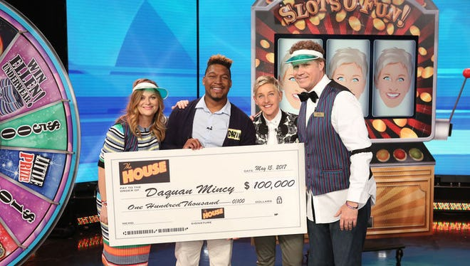 """In this photo released by Warner Bros., a May 15 episode of """"The Ellen DeGeneres Show"""" features Salisbury University student Daquan Mincy (second from left) receiving $100,000."""
