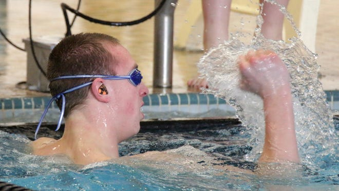 Plymouth's Harrison Strutz reacts to his time in the 50-yard freestyle at the EWC Conference Swim Meet Saturday February 4, 2017 at Plymouth.
