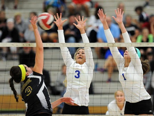 Maddy Rondeau (3) and  Kaitlyn Zingsheim (1) go up for a block for Waukesha Catholic Memorial.