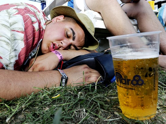 Andrew Benecke takes a nap between concerts at the Bonnaroo Music & Arts Festival on June 12, 2015.