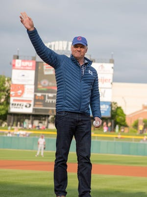 Ryne Sandberg waves to the Victory Field crowd as he throws out the ceremonial first pitch Saturday.